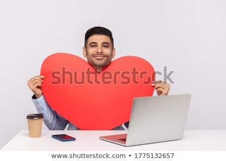 portrait of romantic handsome businessman holding a big red hear Stock photo © feedough