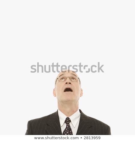 portrait of shocked businessman looking up in disbelief Stock photo © feedough