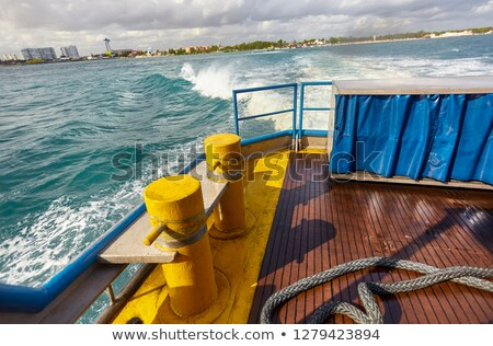 boat bow blue caribbean sea cancun to isla mujeres stock photo © lunamarina