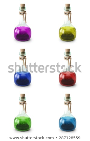 Set of magic potions, perfume or essential oil in glass flasks isolated on multicolored background.  Stock photo © Lady-Luck