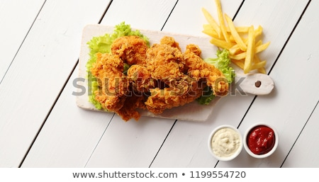 Sauces and lettuce near French fries and chicken wings Stock photo © dash