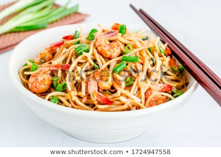 Stock photo: Traditional asian udon stir-fry noodles with shrimp