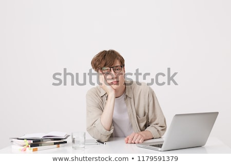 Handsome emotional young man isolated over beige background take a selfie by phone. Stock photo © deandrobot