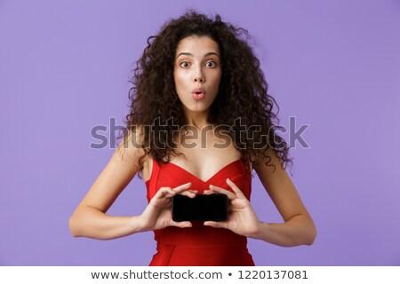 Imagem encantado mulher 20s vestido vermelho Foto stock © deandrobot