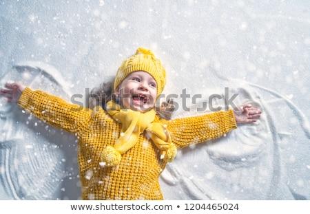 Szczęśliwy mały dzieci śniegu aniołów Zdjęcia stock © dolgachov