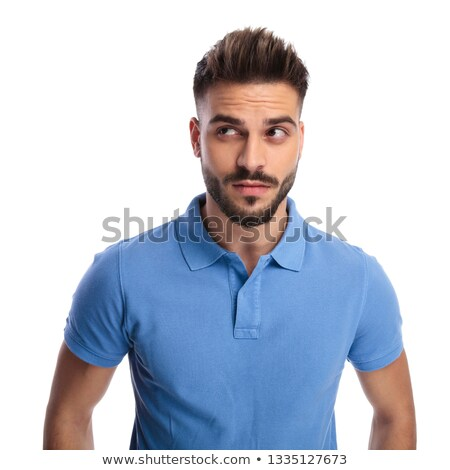 Thoughtful young man wearing a light blue polo looking upwards a Stock photo © feedough