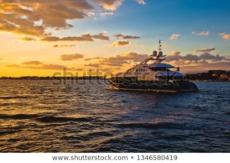 Yachtig at golden sunset view Stock photo © xbrchx