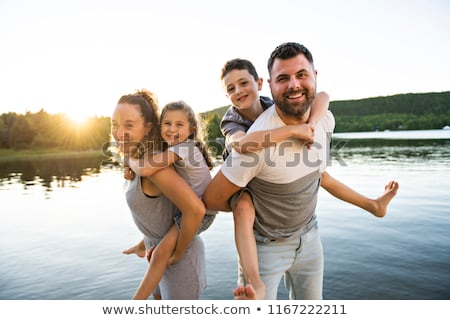 family on the pier warm summer day having good time stock photo © lopolo