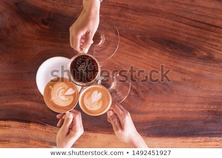 Negotiating by cup of coffee Stock photo © pressmaster