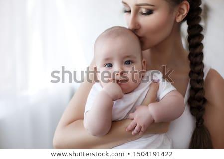 Fiatal anya tart újszülött gyermek baba Stock fotó © Lopolo