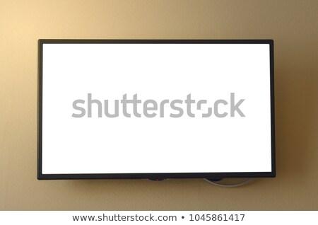 Görmek modern duvar düz ekran televizyon Stok fotoğraf © wavebreak_media