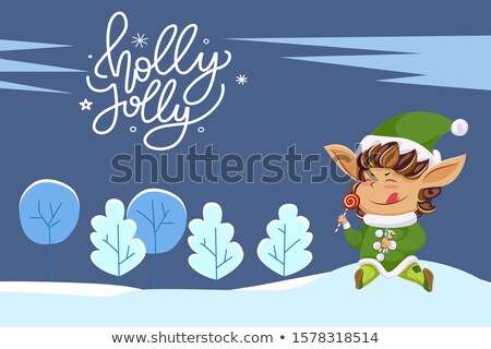 Holly Jolly Elf Eating Lollipop and Landscape Stock photo © robuart