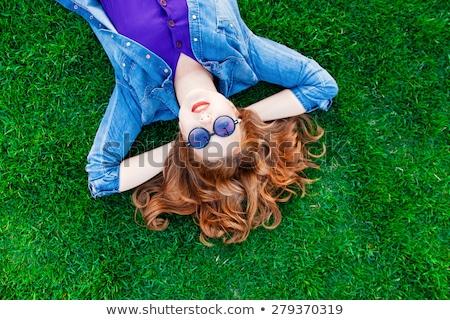 Mujer hierba verde rosa vestido sonrisa Foto stock © pekour