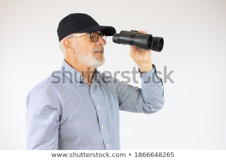 Man holding pair of binoculars stock photo © photography33