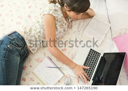 Woman on her bed using laptop stock photo © photography33