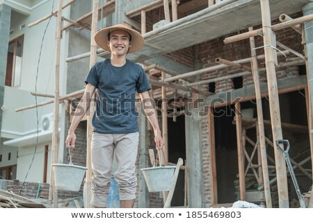 A mason carrying a bucket. Stock photo © photography33