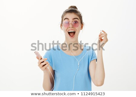 Girl screaming down an old fashioned phone Stock photo © photography33