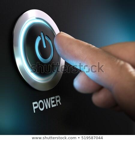 Man pressing ON / OFF button Stock photo © ra2studio