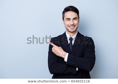 business man pointing presenting stock photo © feedough