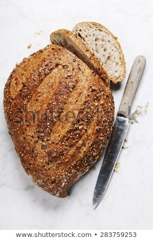 large bread knife on natural stone stock photo © tab62