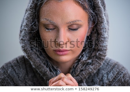 Woman praying. Wearing hoodie. Frost on her face Stock photo © HASLOO