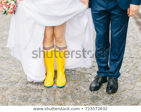 bride and groom under umbrella Stock photo © m_pavlov