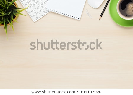 Office table with flower, supplies and coffee cup Stock photo © karandaev