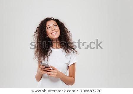 peinzend · jonge · vrouw · naar · omhoog · portret · Blauw - stockfoto © hasloo