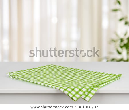 Green checkered tablecloth on a white wooden background Stock photo © Zerbor