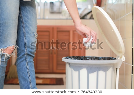Woman Putting Garbage in Can and Plastic Bag Stock photo © stevanovicigor