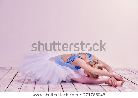 Tired ballet dancer lying on the wooden floor  stock photo © master1305