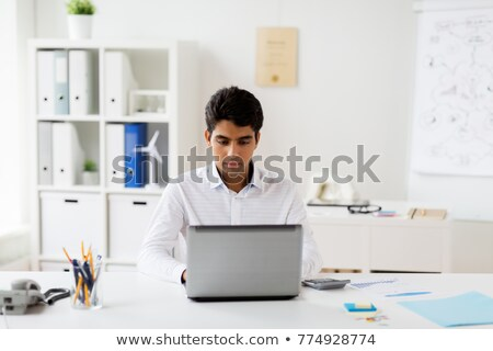 south indian businessman working in an office stock photo © imagedb
