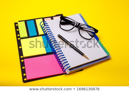 Blank copybook with tablet and sticker Stock photo © cherezoff