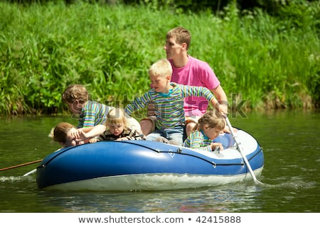 Gyerekek vezetés felfújható csónak felügyelet felnőttek Stock fotó © Paha_L
