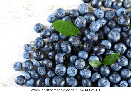 Tasty ripe blueberry pile on wooden background Stock photo © stevanovicigor