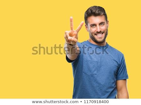 Stockfoto: Gelukkig · jonge · man · tonen · winnend · gebaar · geïsoleerd