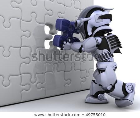 Robot met het laatste stukje van de puzzel Stockfoto © Kjpargeter