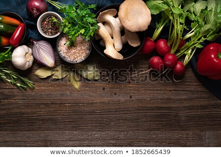 Fresh radishes with green onions and salt on a wooden table Stock photo © Yatsenko