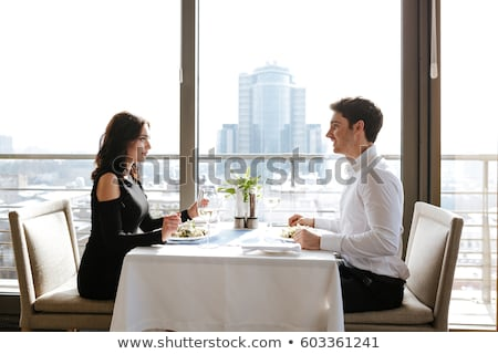 Side view of woman with man in cafe Stock photo © deandrobot