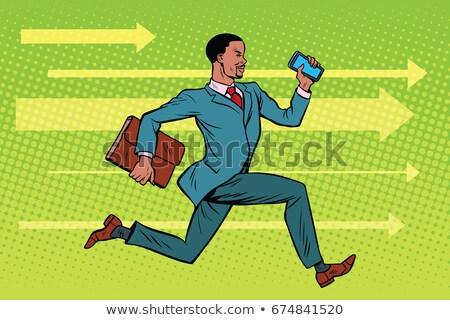 Businessman with a smartphone running fast forward Stock photo © studiostoks