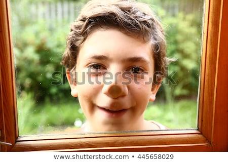 Teenage boys eye and nose against white background Stock photo © wavebreak_media