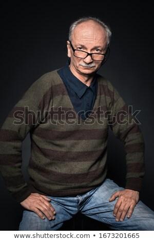 handsome guy on dark background in studio Stock photo © chesterf