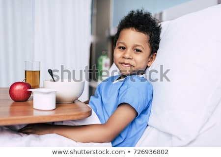 african american boy with breakfast in clinic stock photo © LightFieldStudios