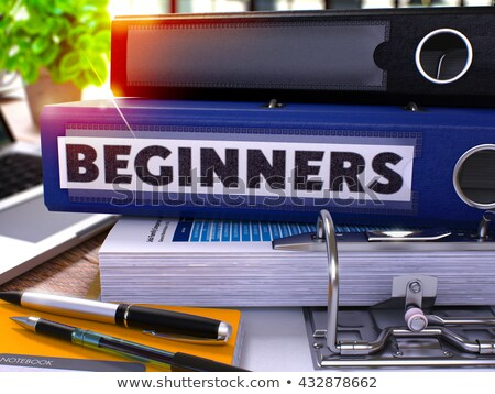 Blue Office Folder with Inscription Beginners. Stock photo © tashatuvango