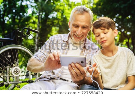Grandfather with grandson at picnic Stock photo © IS2