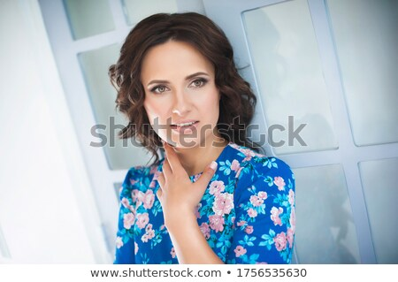 Photo closeup of attractive young woman with curly hair in summe Stock photo © deandrobot