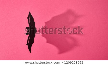 Handcraft paper bat on a red background with shadow and copy space for text. Layout to Halloween. Fl Stock photo © artjazz