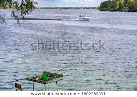 Stock photo: Fishing Man from Platform, Boat and from Bank
