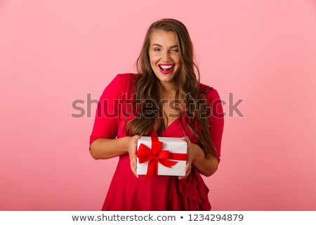 Photo of seductive chubby woman 20s wearing red dress smiling an Stock photo © deandrobot