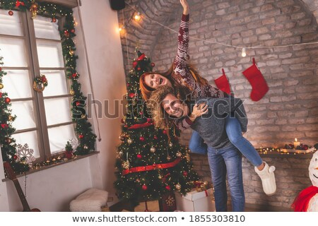 幸せ 男 ピギーバック 妻 ホーム 肖像 ストックフォト © AndreyPopov